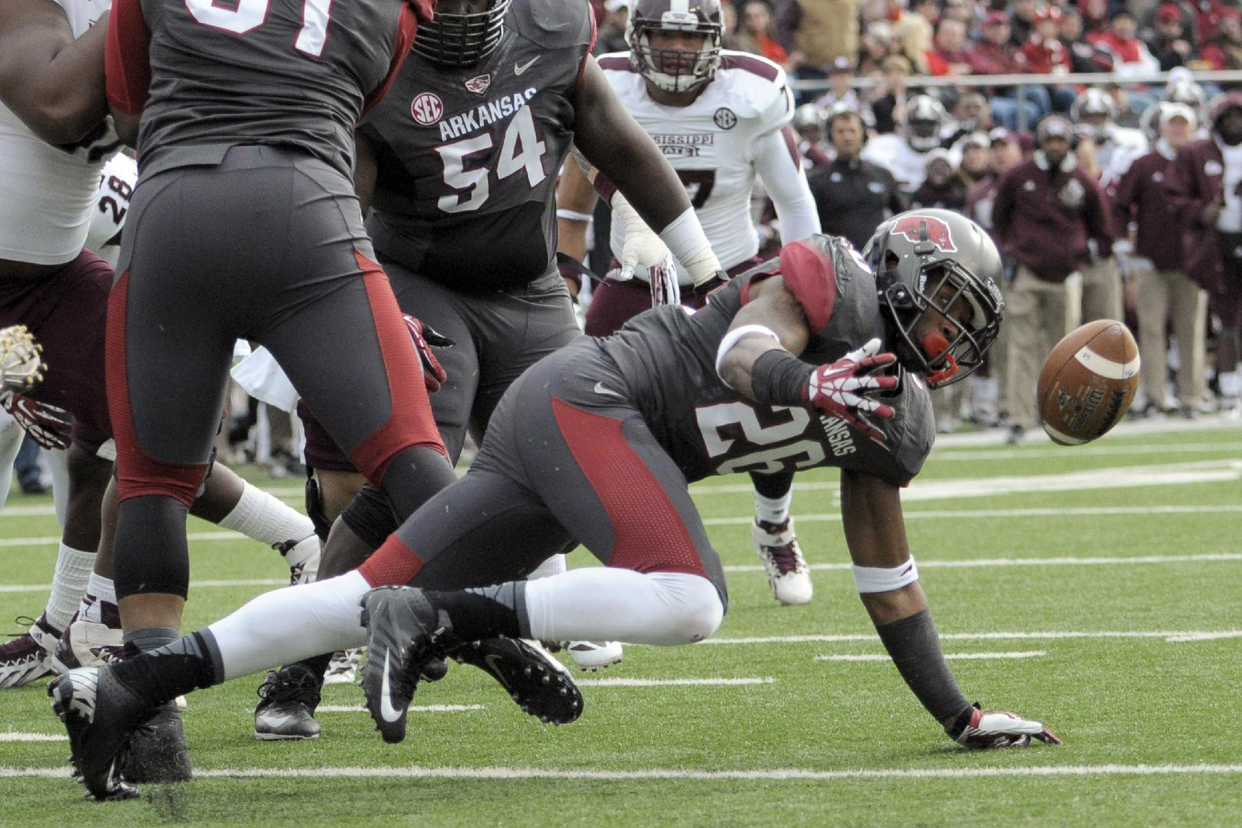 Arkansas safety Rohan Gaines recovers a Mississippi State fumble at the one-yard line in the second quarter of an NCAA college football game in Little Rock, Ark., Saturday, Nov. 23, 2013
