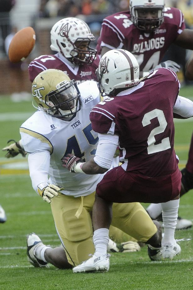 Georgia Tech defensive end Jeremiah Attaochu (45) forces a fumble as he tackles Alabama A&M wide receiver Terrance Pride (2) during the first quarter of an NCAA college football game, Saturday, Nov. 23, 2013, in Atlanta