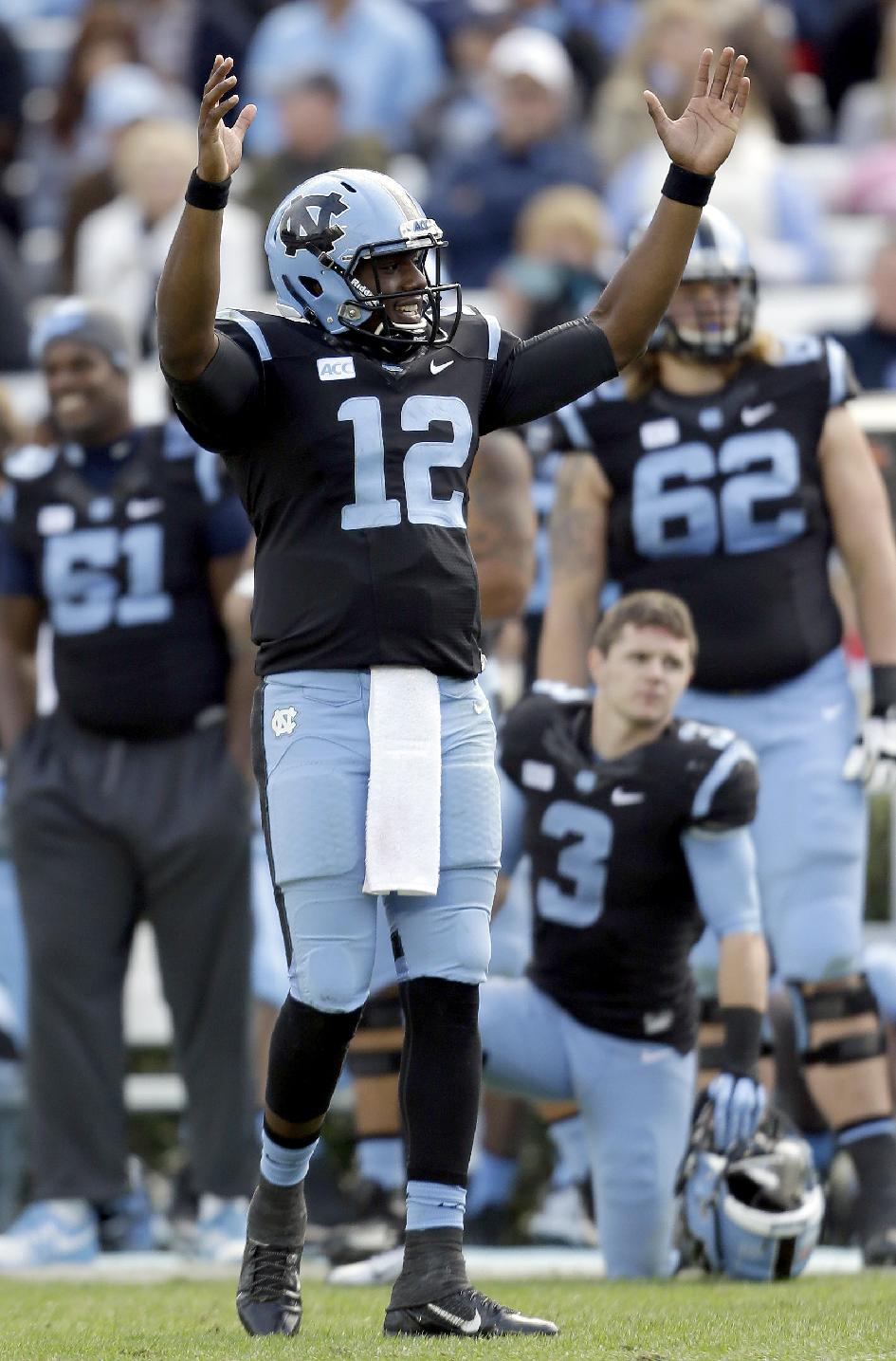 North Carolina quarterback Marquise Williams (12) reacts following a play under review during the second half of an NCAA college football game against Old Dominion in Chapel Hill, N.C., Saturday, Nov. 23, 2013. North Carolina won 80-20