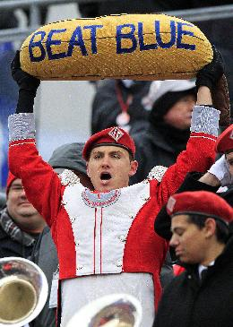 In this Nov. 24, 2012 file photo,  an Ohio State band member cheers during an NCAA college football game against Michigan  in Columbus, Ohio. It has already been a successful season for No. 3 Ohio State, but as the Buckeyes know, no season is a success if they lose to their chief rivals, the Michigan Wolverines