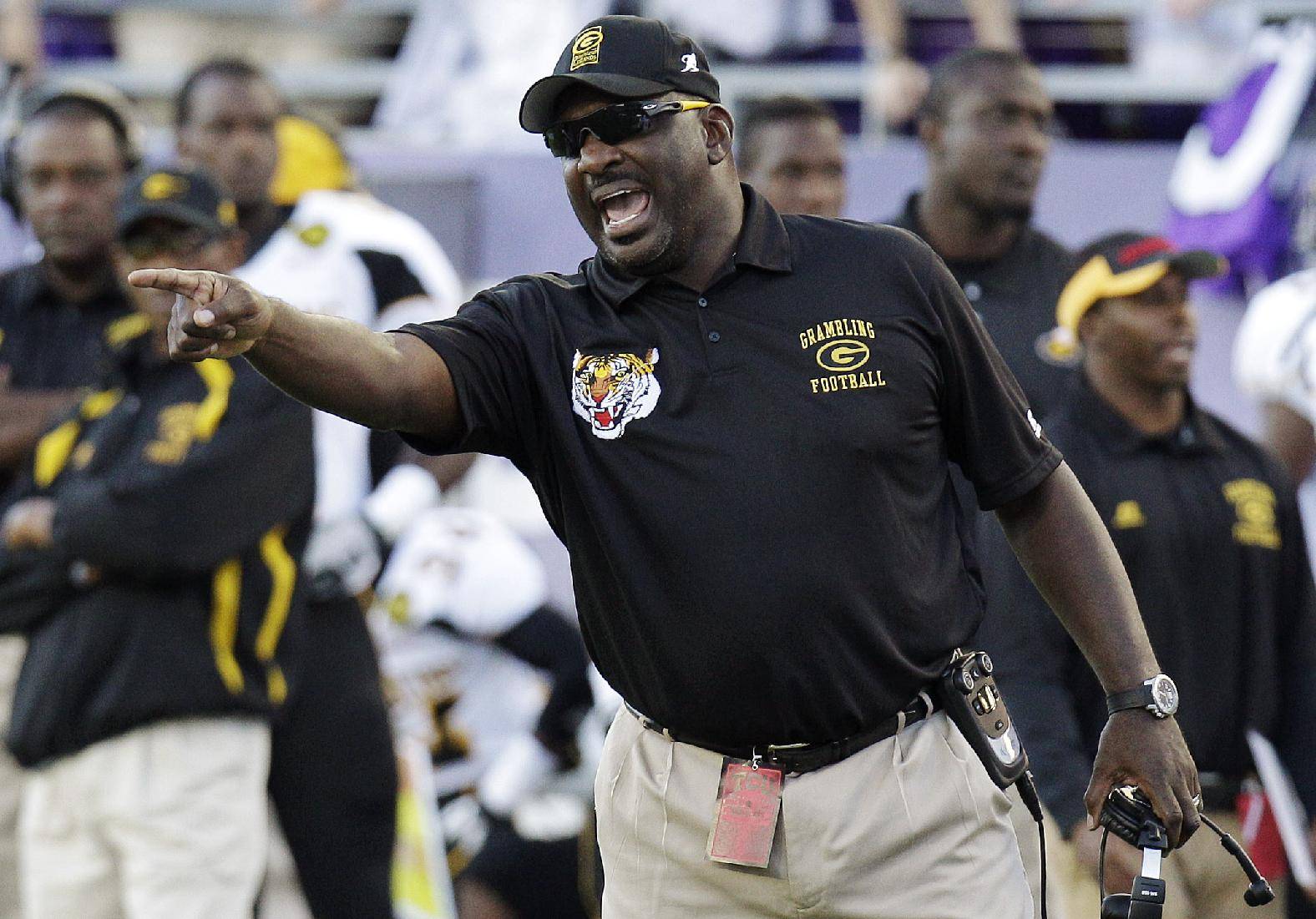 In this Sept. 8, 2012, file photo, Grambling State coach Doug Williams yells from the sideline during an NCAA college football game against TCU in Fort Worth, Texas. Williams was fired two games into the 2013 season, despite a 61-34 record and four conference titles. He said he was given no reason for his dismissal. Grambling's season comes to an end Saturday, Nov. 30, against Southern University in the Bayou Classic in New Orleans