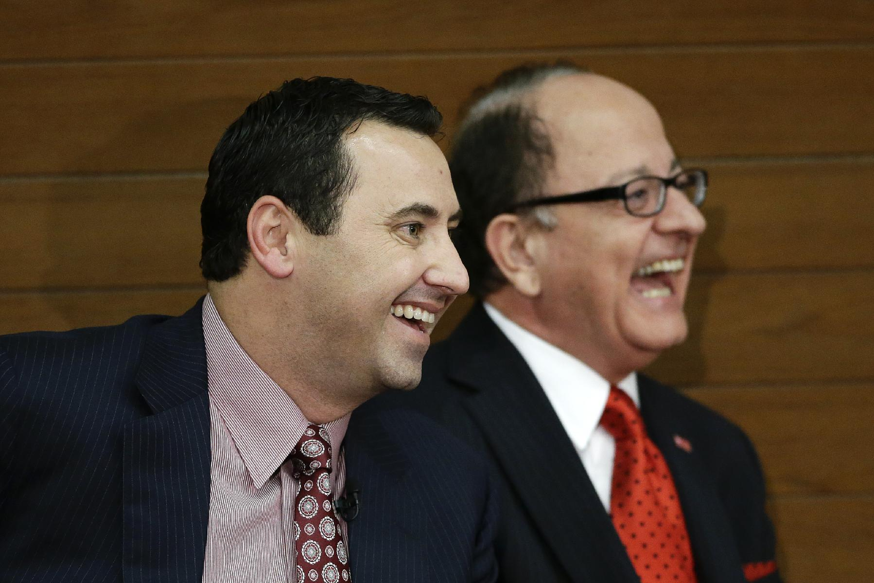 New Southern California football head coach Steve Sarkisian, left, and USC president, C. L. Max Nikias laugh during a news conference on Tuesday, Dec. 3, 2013, in Los Angeles. USC hired Sarkisian away from Washington on Monday, bringing back the former Trojans offensive coordinator to his native Los Angeles area and the storied program where he thrived as Pete Carroll's assistant