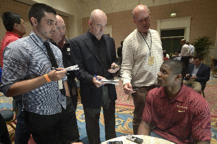 Florida State defensive back Lamarcus Joyner, right, answers questions during a media availability prior to the College Football Awards show in Lake Buena Vista, Fla., Wednesday, Dec. 11, 2013