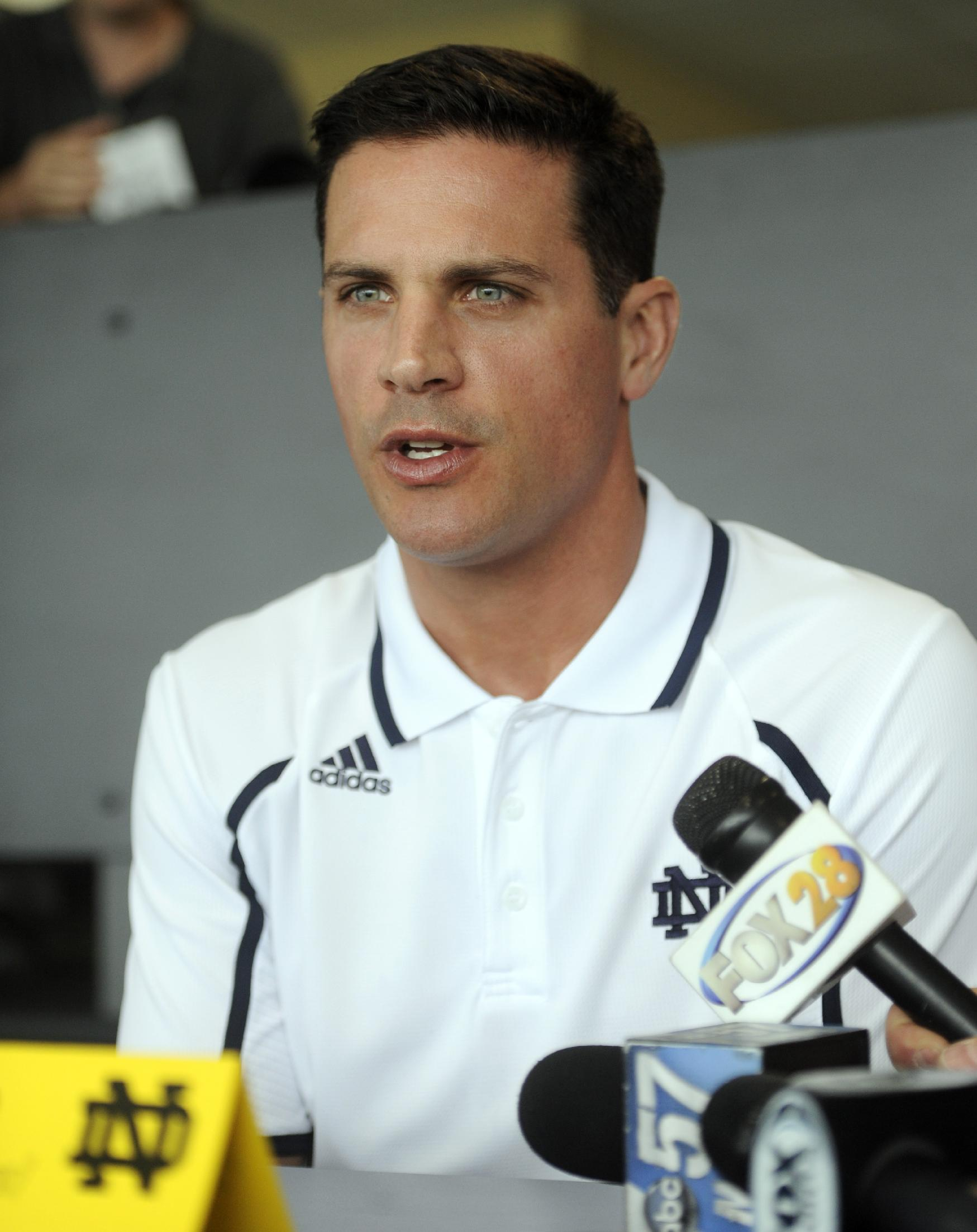 FILe - In this Aug. 22, 2013 file photo, Notre Dame defensive coordinator Bob Diaco answers questions from the media at NCAA college football media day in South Bend, Ind. Connecticut has hired Notre Dame defensive coordinator Bob Diaco as its football coach. The school announced the move early Thursday morning, Dec. 12, 2013