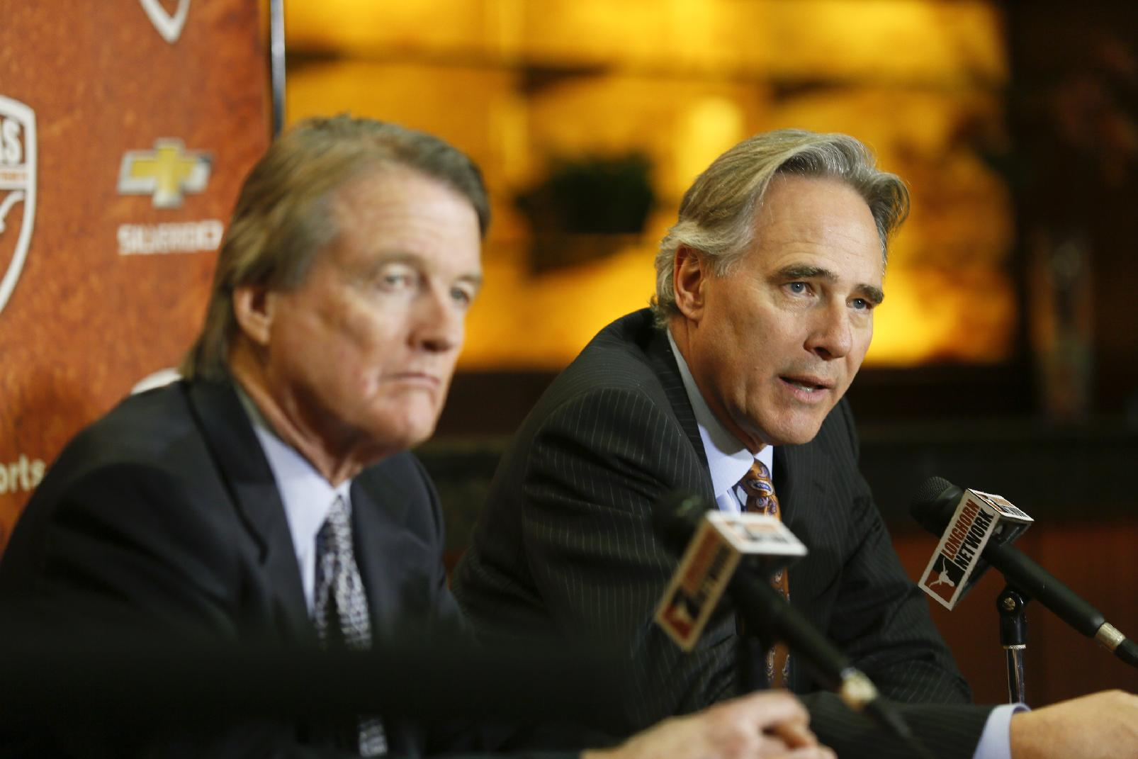 University of Texas president Bill Powers, left, and athletic director Steve Patterson discuss a search for a new head football coach in Austin, Texas on Sunday, Dec. 15, 2013. Current coach Mack Brown announced he was stepping down from the position following the Valero Alamo Bowl on Dec. 30