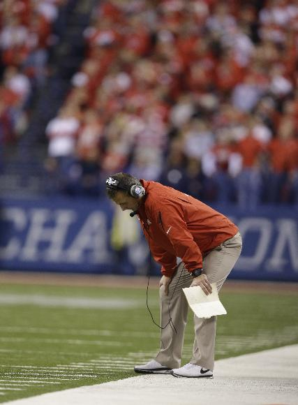 In this Dec. 7, 2013 file photo, Ohio State head coach Urban Meyer hangs his head on the sidelines in the second half of a 32-24 loss to Michigan State in the Big Ten Conference championship NCAA college football game in Indianapolis. Meyer believes he has matured in his 12 years as a head coach. An admitted