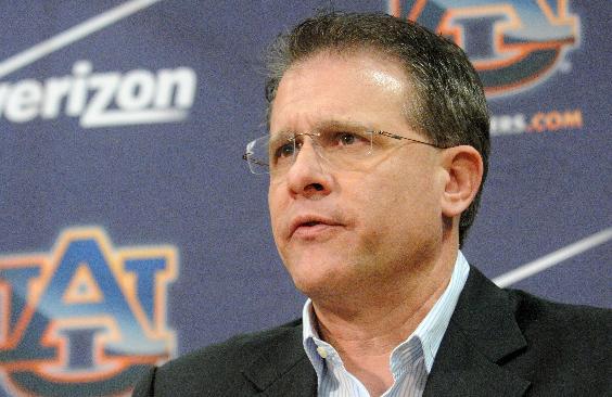 Auburn football head coach Gus Malzahn talks to members of the media on Wednesday, Dec. 18, 2013, in Auburn, Ala