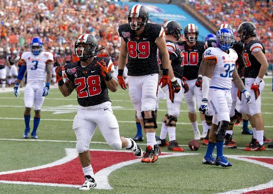 Oregon State running back Terron Ward (28) celebrates after scoring against Boise State in the Hawaii Bowl NCAA college football game in Honolulu, Tuesday, Dec. 24, 2013