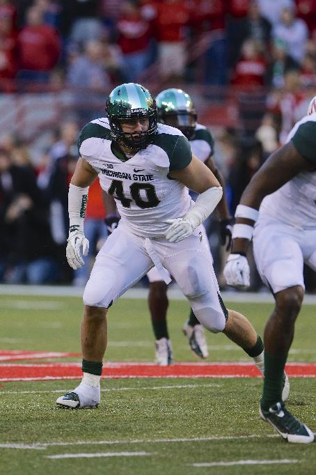 Michigan State linebacker Max Bullough (40) runs in the second half of an NCAA college football game against Nebraska in Lincoln, Neb., Saturday, Nov. 16, 2013