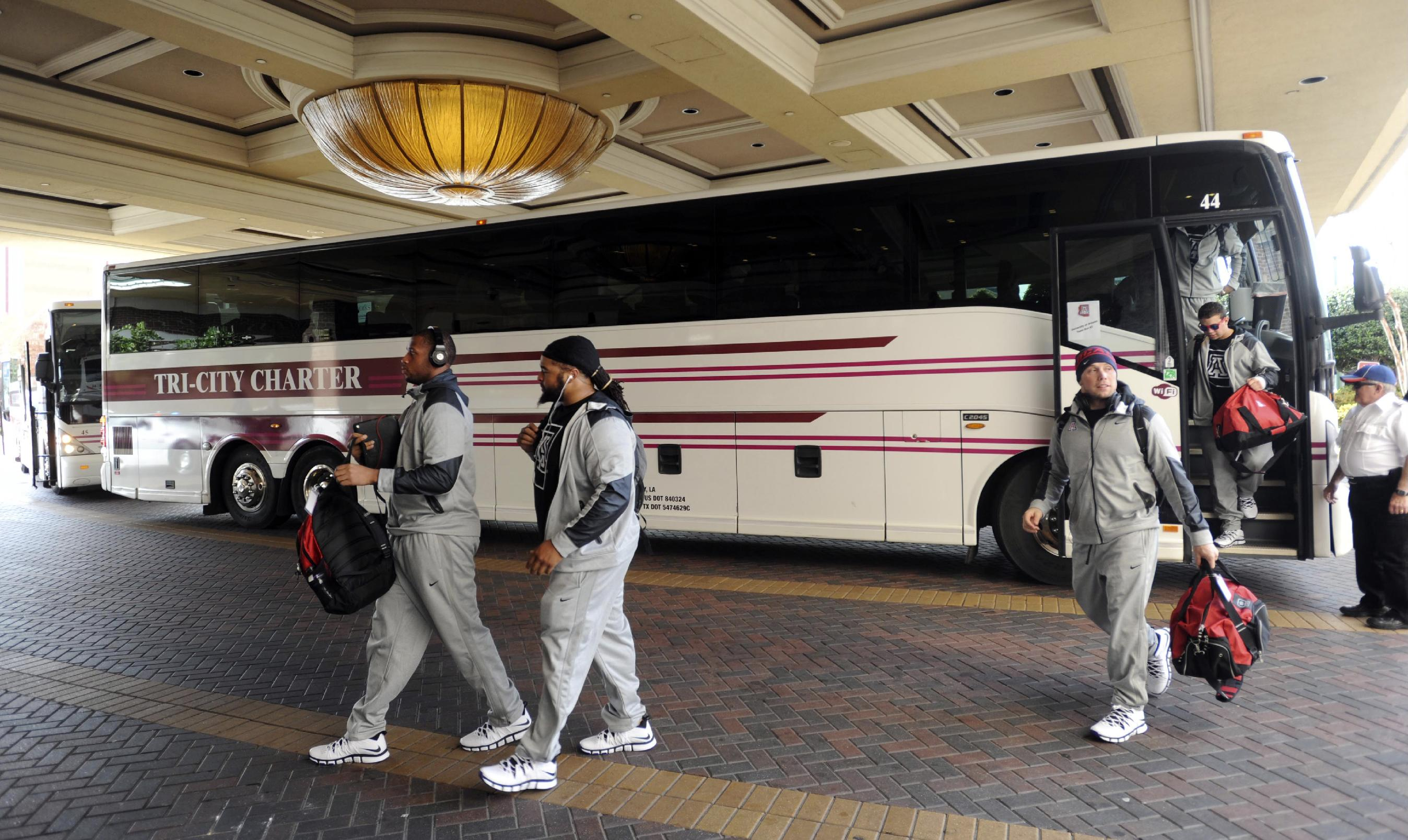 Arizona players arrive in Shreveport, La., Friday Dec. 27, 2013. Arizona takes on Boston College in the AdvoCare V100 Bowl NCAA college football game on Tuesday, Dec. 31