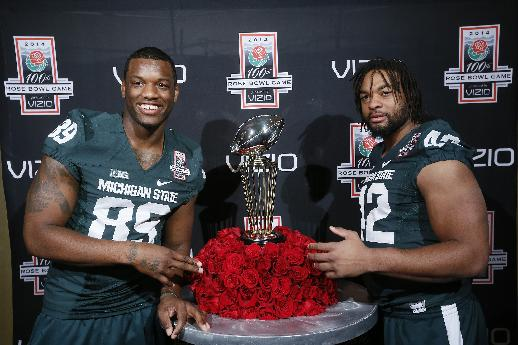 Michigan State defensive ends: Evan Jones, left, and Enzel Drone pose for a photo with the Leishman Trophy, during media day on Sunday, Dec. 29, 2013, in Los Angeles. The Rose Bowl Game Trophy, also known as the Leishman Trophy, is awarded each year to the Rose Bowl champion. Michigan State faces Stanford in the 100th Rose Bowl NCAA college football game on New Year's Day