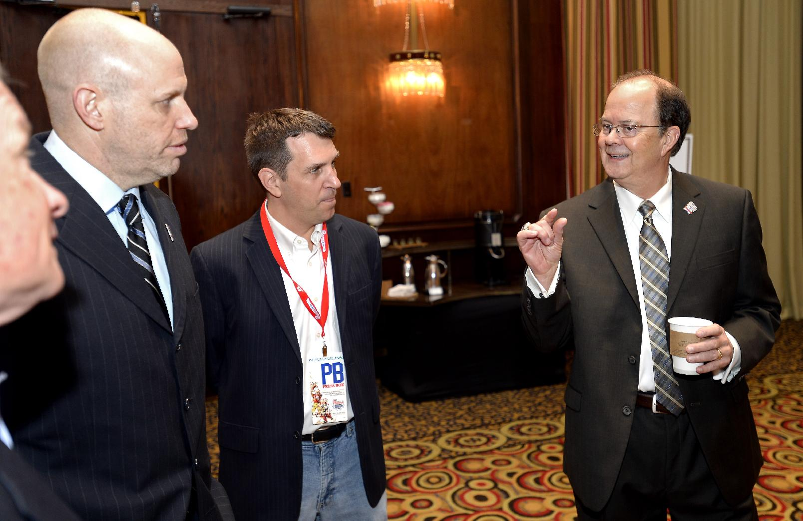 Duke head football coach David Cutcliffe, right, attends a Chick-fil-A Bowl reception before he is named the Bobby Dodd Coach of the Year on Monday, Dec. 30, 2013, in Atlanta. Cutcliff's Duke team faces Texas A&M for the Chick-fil-A Bowl on Tuesday night