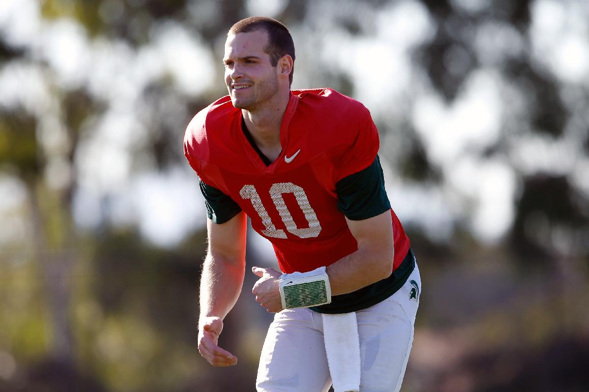 In a photo from Dec. 28, 2013, Michigan State backup quarterback Andrew Maxwell stretches during Michigan State's open practice at StubHub Center in Carson, Calif. The former starter talked Sunday about the bittersweet journey of his senior season. Maxwell told MLive.com in Los Angeles that the sweetness of reaching the Rose Bowl far outweighs the bitterness he had to endure when he lost a much-publicized quarterback competition to current Spartans' starter Connor Cook in September