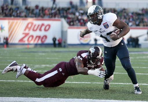Rice running back Charles Ross, right, evades Mississippi State defensive lineman Denico Autry as Ross scores a touchdown on a 1-yard run in the first quarter of the Liberty Bowl  NCAA college football game on Tuesday, Dec. 31, 2013, in Memphis, Tenn