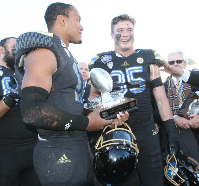 UCLA's Brett Hundley, left, and Jordan Zumwalt smile after they were announced as co-MVPs after defeating Virginia Tech 42-12 in an NCAA college football game Tuesday Dec. 31, 2013, in El Paso, Texas