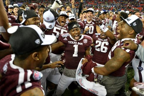 Texas A&M celebrates their win over Duke in the Chick-fil-A Bowl Tuesday Dec. 31, 2013, in Atlanta