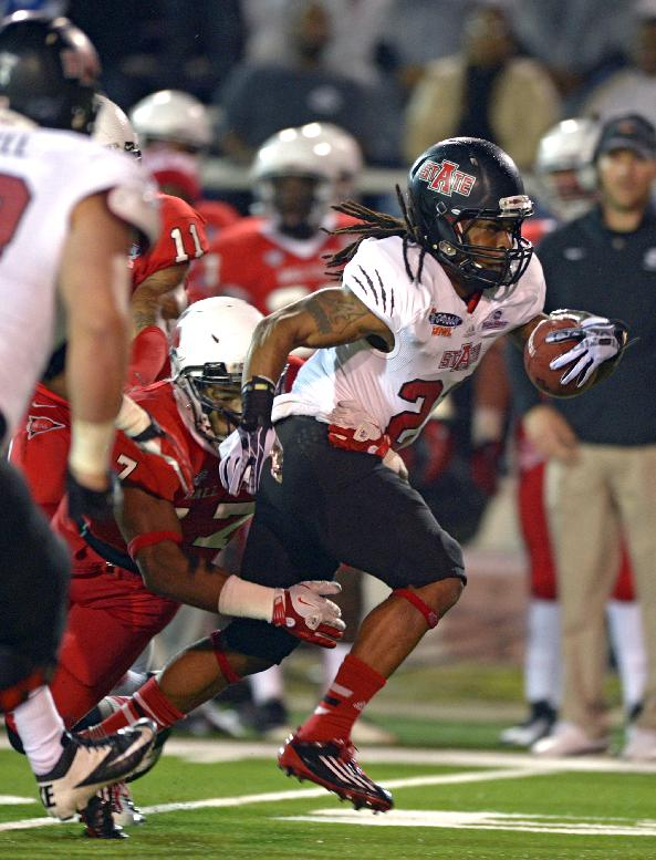 Arkansas State wide receiver J.D. McKissic (23) is tackled by Ball State linebacker Kenneth Lee (17) in the first quarter of the GoDaddy Bowl NCAA college football game in Mobile, Ala., Sunday, Jan. 5, 2014