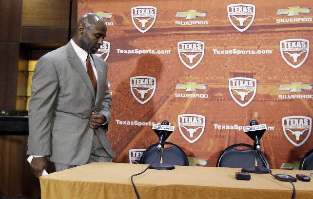 Charlie Strong arrives for a news conference where he was introduced as the new Texas football coach, Monday, Jan. 6, 2014, in Austin, Texas. Strong replaces Mack Brown, who coached Texas for 16 years and won the 2005 national championship. Strong spent the previous four years at Louisville