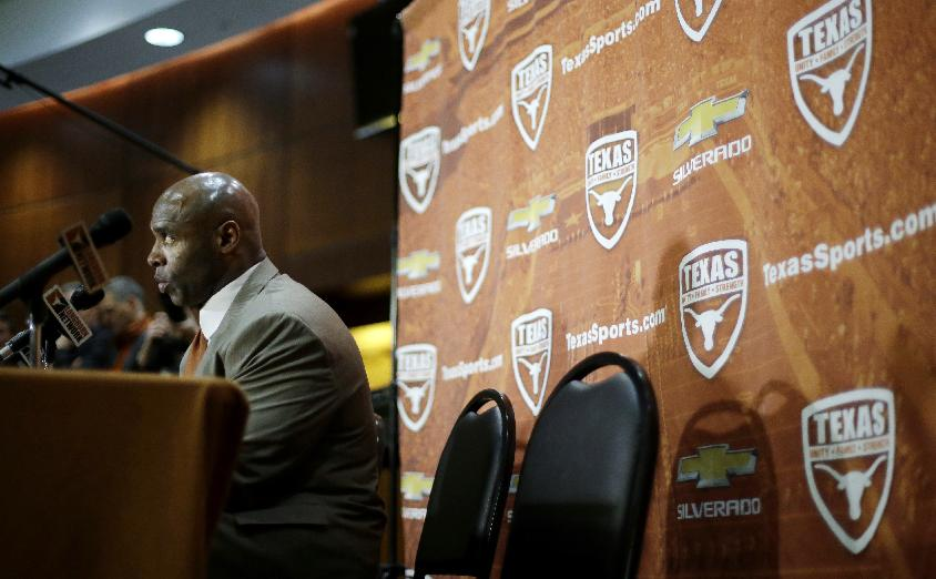 Charlie Strong answers questions during an NCAA college football news conference where he was introduced as the new Texas football coach, Monday, Jan. 6, 2014, in Austin, Texas. Strong replaces Mack Brown, who coached Texas for 16 years and won the 2005 national championship