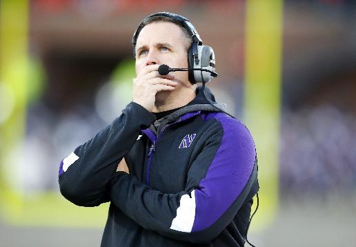 Northwestern head coach Pat Fitzgerald looks at the scoreboard during an NCAA college football game on Saturday, Nov. 30, 2013, against Illinois in Champaign, Ill