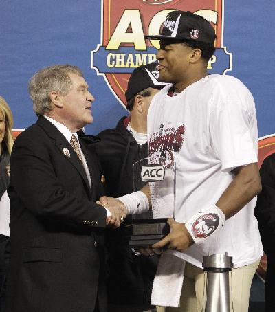 ACC commissioner John Swofford, left, hands Florida State's Jameis Winston the MVP trophy after the Atlantic Coast Conference Championship NCAA football game in Charlotte, N.C., Saturday, Dec. 7, 2013. Florida State defeated Duke 45-7