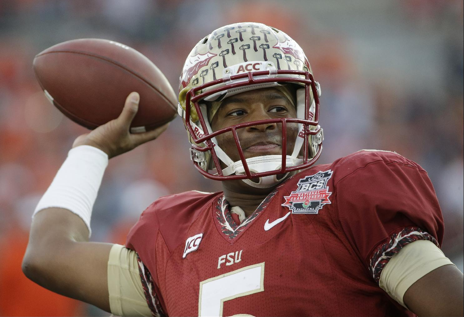 This Jan. 6, 2014 file photo shows Florida State quarterback Jameis Winston warming up before the NCAA BCS National Championship college football game against Auburn in Pasadena, Calif. The attorney for a woman who accused Winston of sexual assault says she will sue the school, the Tallahassee Police Department and the player himself, Thursday, Jan. 9, 2014