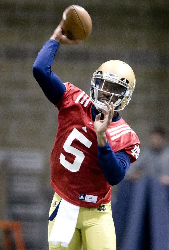 Notre Dame quarterback Everett Golson throws on the opening day of spring football practice, Monday, March 3, 2014, in South Bend, Ind