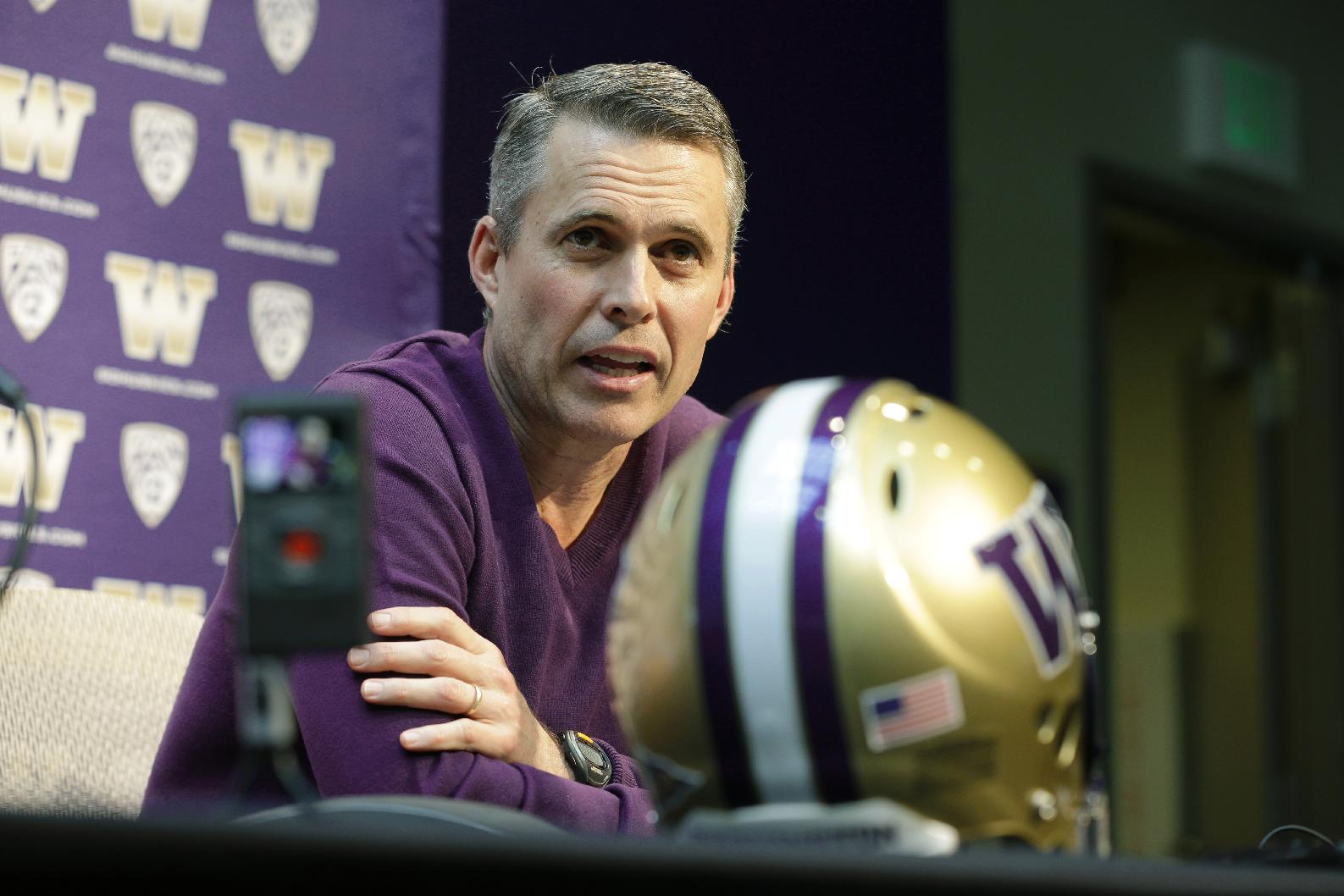 Washington head football coach Chris Petersen talks to reporters Monday, March 3, 2014, in Seattle. Washington begins spring NCAA college football practice on Tuesday, March 4, 2014