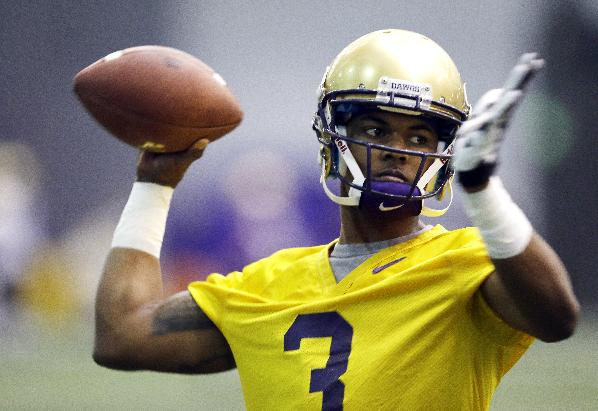 Washington redshirt quarterback Troy Williams passes on the first day of spring NCAA college football practice Tuesday, March 4, 2014, in Seattle