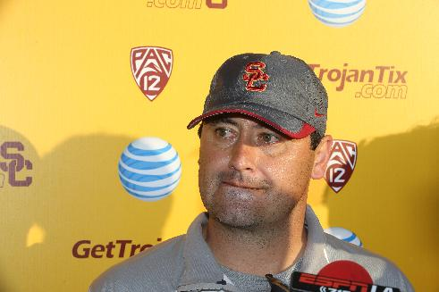 Southern California coach Steve Sarkisian takes questions from members of the media after spring practice for the NCAA college football team in Los Angeles, Thursday, March 13, 2014