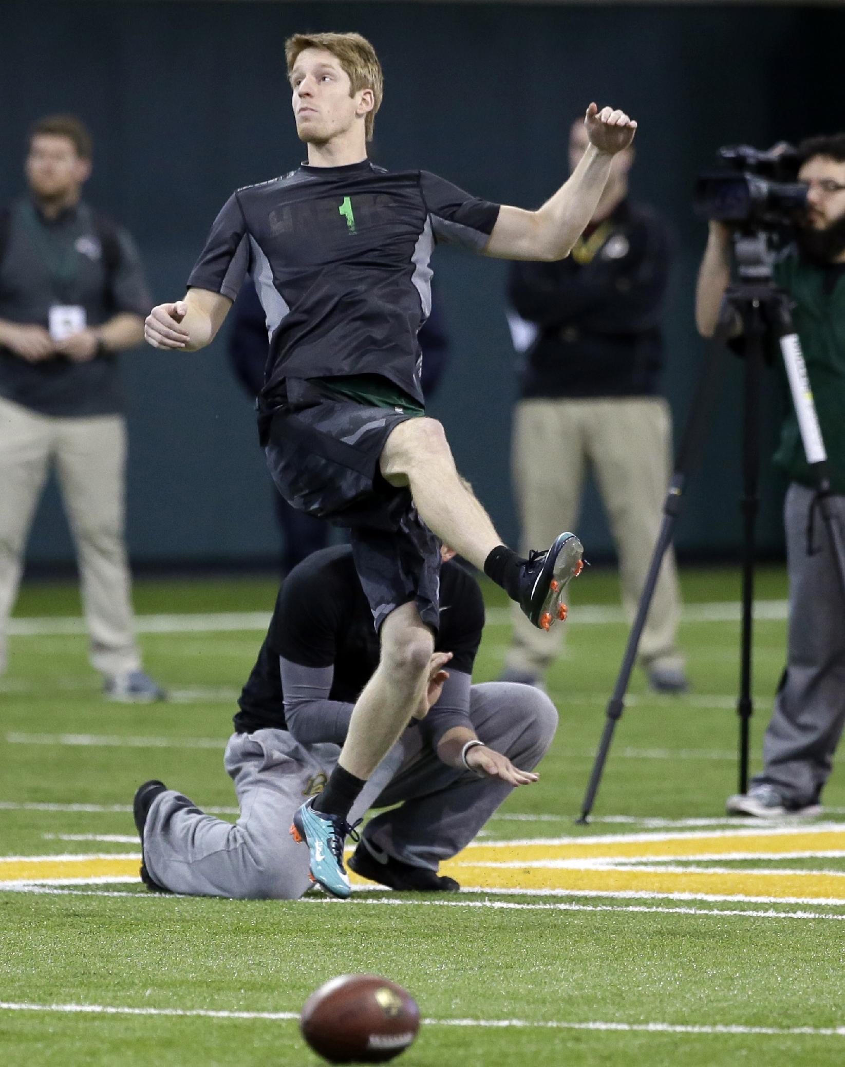 Baylor kicker Aaron Jones watches the flight of the ball as he works out during pro day for NFL football representatives on Wednesday, March 19, 2014, in Waco, Texas