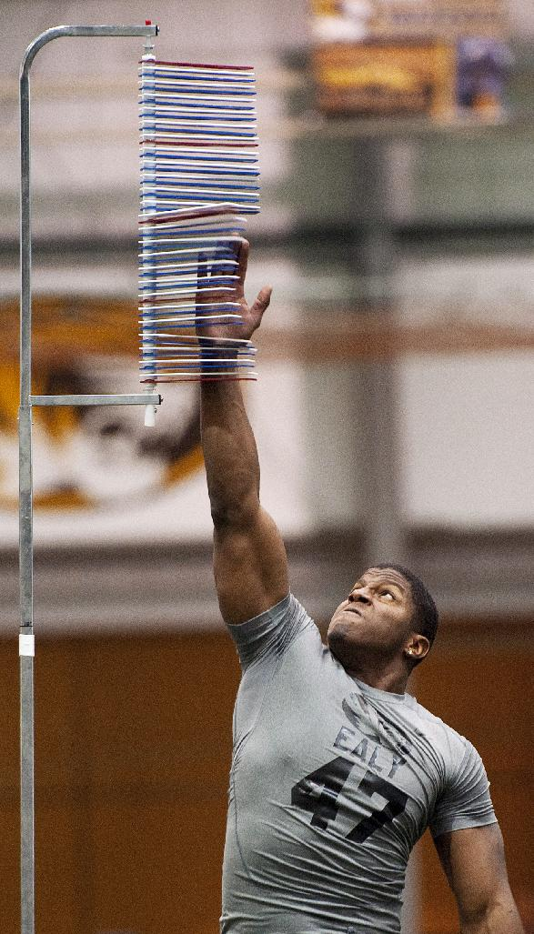 Missouri defensive lineman Kony Ealy participates in a vertical jump drill during pro day for NFL football representatives Thursday, March 20, 2014, in Columbia, Mo