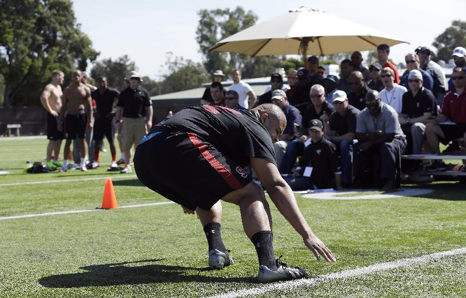 Stanford guard David Yankey runs a drill during pro day for NFL football representatives in Stanford, Calif., Thursday, March 20, 2014