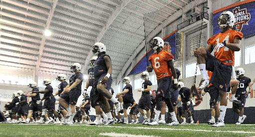 In this photo taken on Tuesday, March 18, 2014, Auburn quarterbacks Jeremy Johnson (6) and Nick Marshall (14) stretch during Auburn's first spring NCAA college football practice at the Auburn Athletic Complex in Auburn, Ala. (AP PHOTO/AL.com, Julie Bennett)