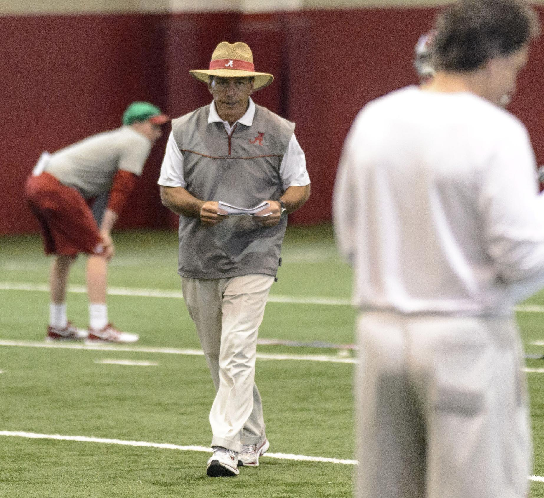 Alabama head coach Nick Saban tracks his defense during NCAA college football practice on Friday, April 4, 2014, in Tuscaloosa, Ala