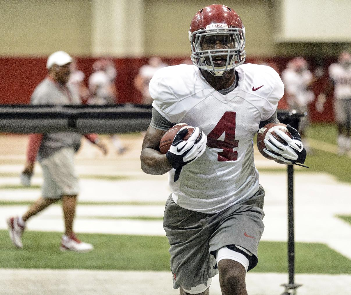 Alabama running back T.J. Yeldon (4) works through running back drills during NCAA college football practice on Friday, April 4, 2014, in Tuscaloosa, Ala