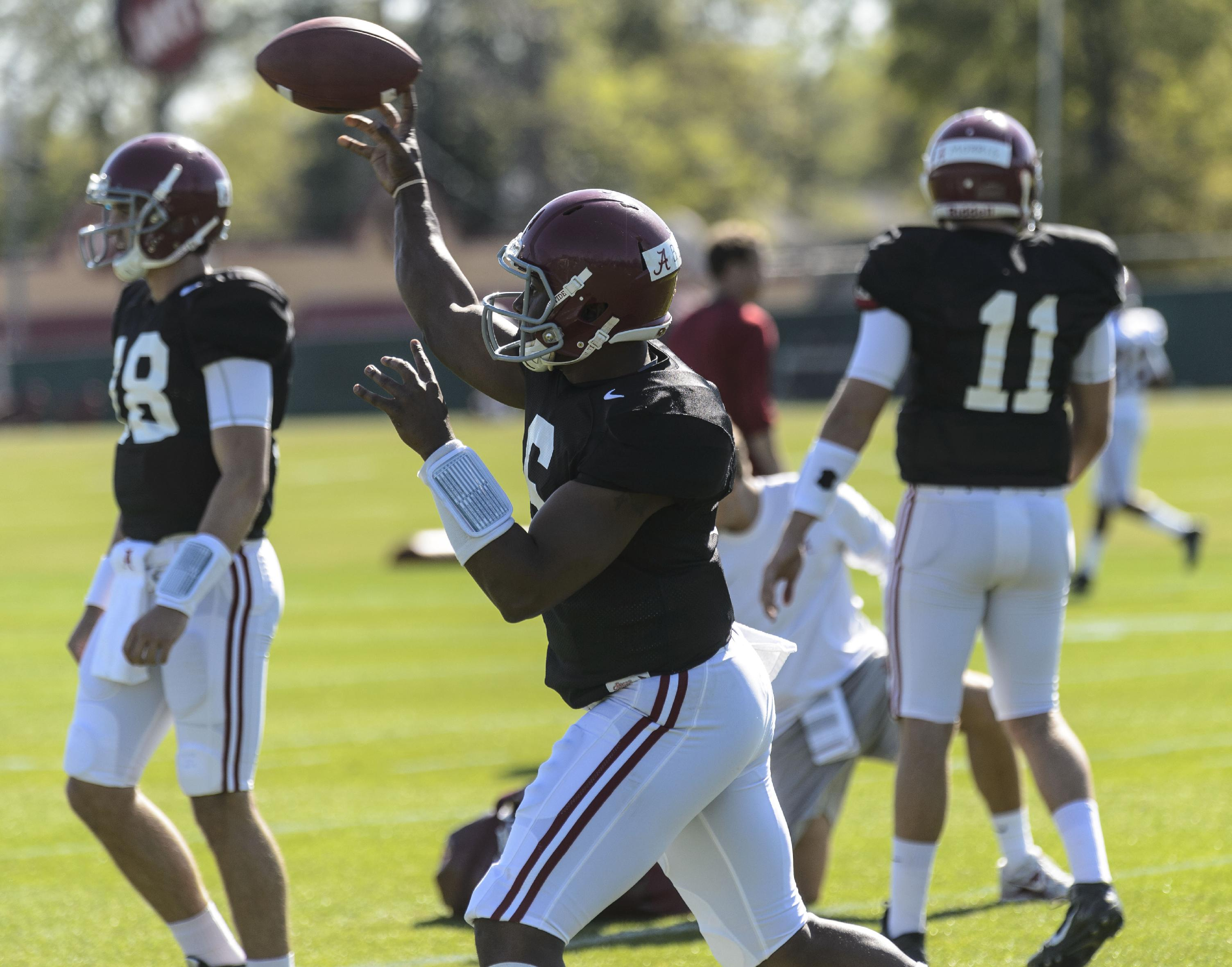 Alabama quarterback Blake Sims (6) passes in drills during NCAA college football spring football practice on Wednesday, April 9, 2014, at the Thomas-Drew Practice Facility in Tuscaloosa, Ala