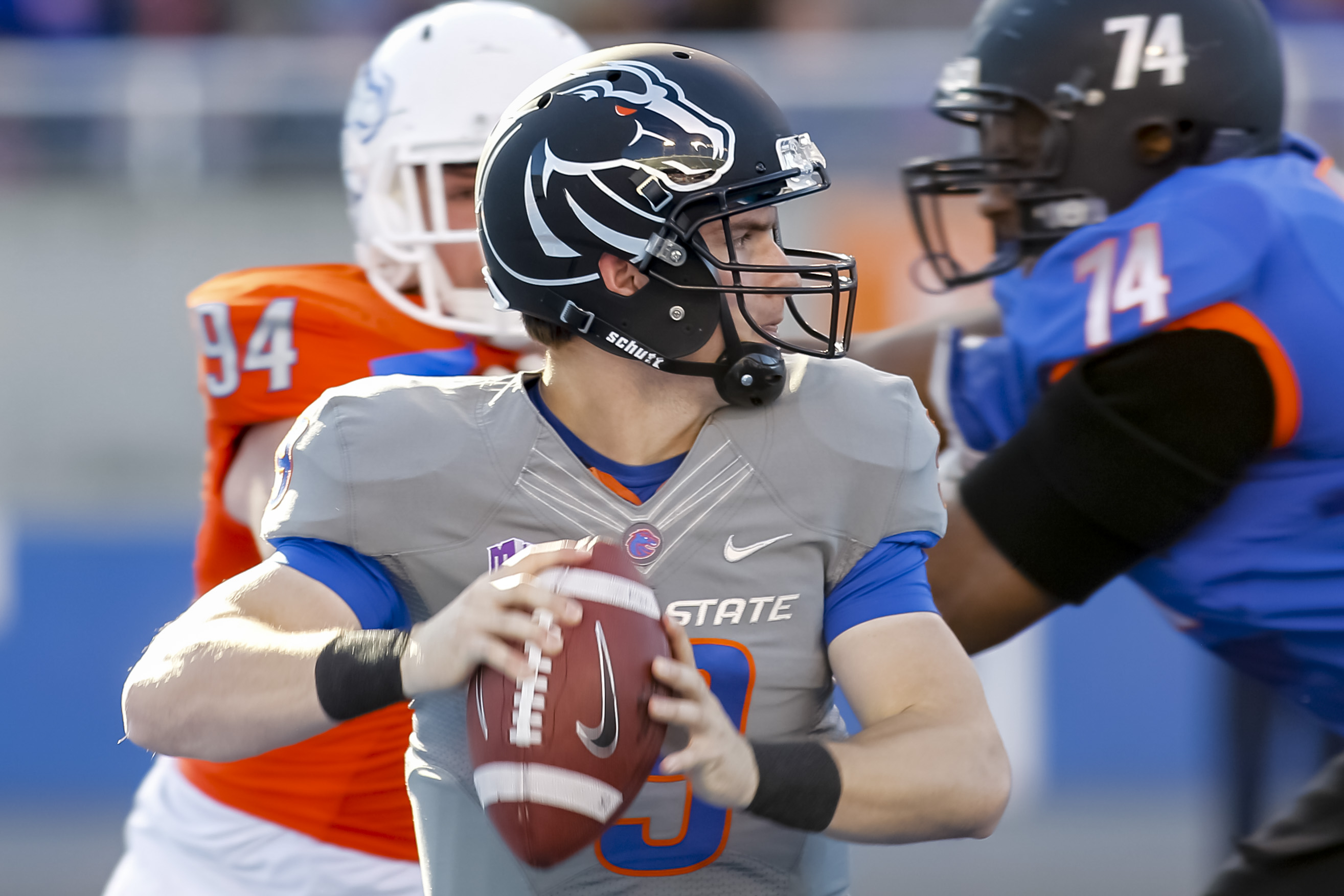 Boise State quarterback Grant Hedrick looks for a receiver during the first half of an NCAA college spring football scrimmage in Boise, Idaho, Saturday, April 12, 2014