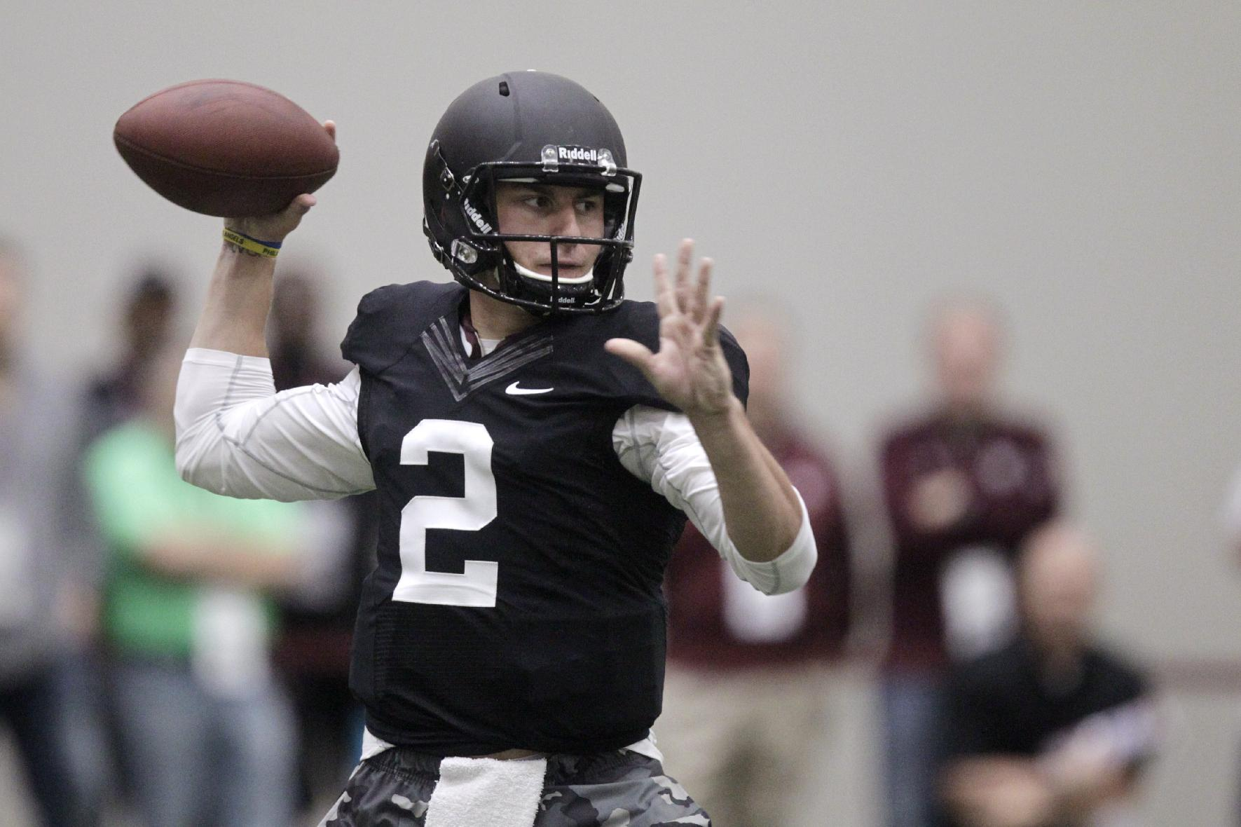 Texas A&M quarterback Johnny Manziel passes the ball during a drill at pro day for NFL football representatives in College Station, Texas, Thursday, March 27, 2014