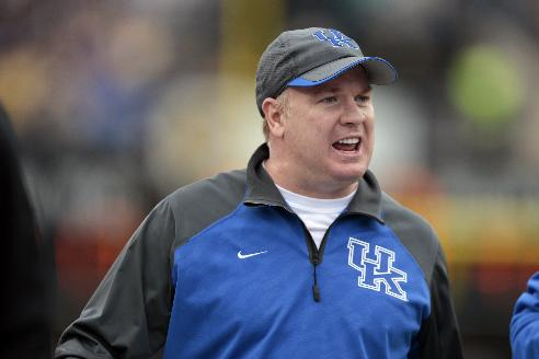 Kentucky head coach Mark Stoops watches from the sideline in the second quarter of an NCAA college football game against Vanderbilt on Saturday, Nov. 16, 2013, in Nashville, Tenn