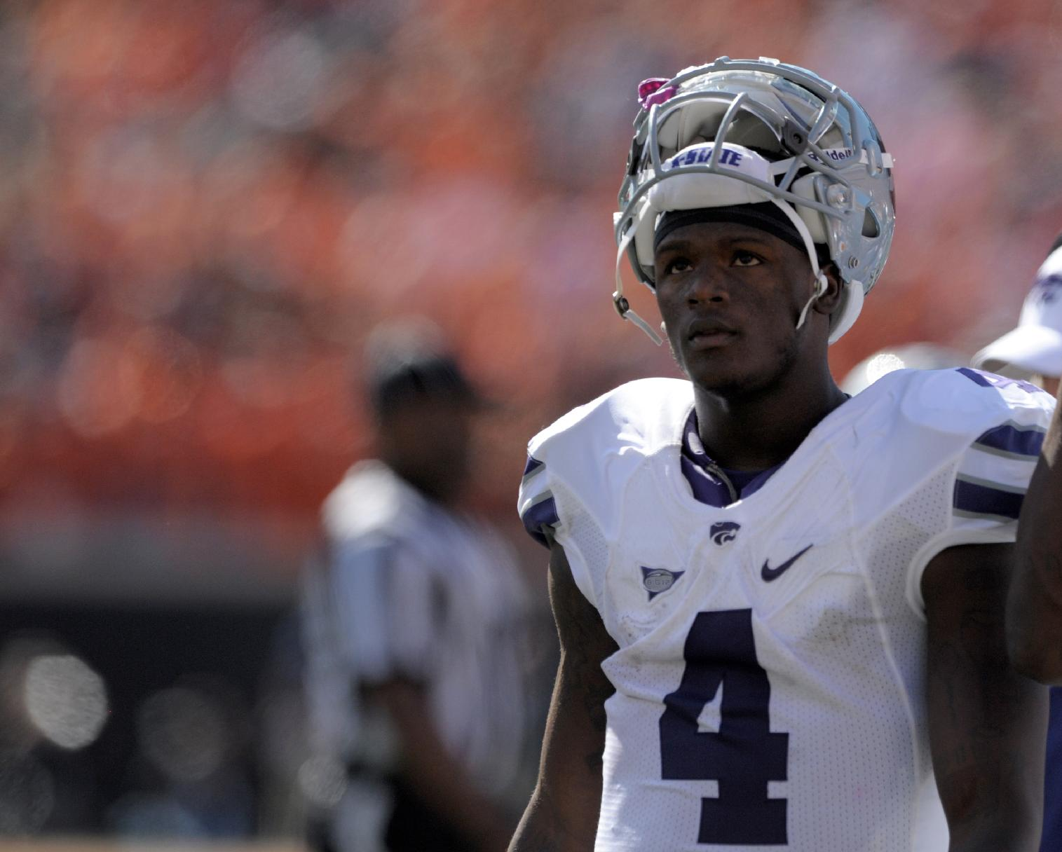 In this Oct. 5, 2013 file photo, Kansas State quarterback Daniel Sams looks up to the scoreboard during a timeout at an NCAA football game against Oklahoma State in Stillwater, Okla. Former quarterback Daniel Sams was granted a conditional release from Kansas State on Tuesday, May 13, 2014, to pursue playing opportunities closer to his home in Slidell, Louisiana. The release only allows Sams to contact Football Championship Subdivision schools with the exception of Stephen F. Austin, which plays Kansas State this season. It does not allow the former starting quarterback to transfer to another Bowl Subdivision school