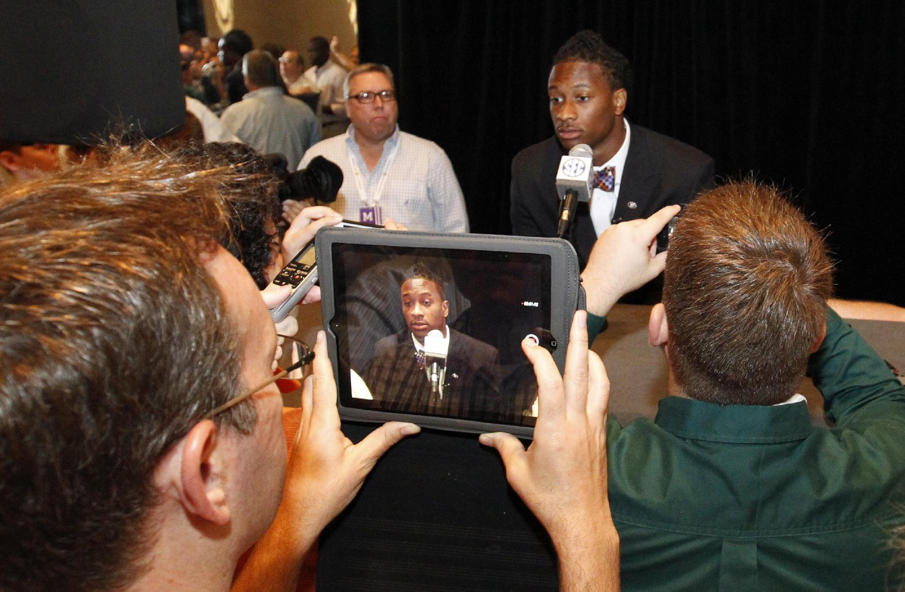 Georgia tailback Todd Gurley speaks to the media at the Southeastern Conference NCAA college football media days, Thursday, July 17, 2014, in Hoover, Ala