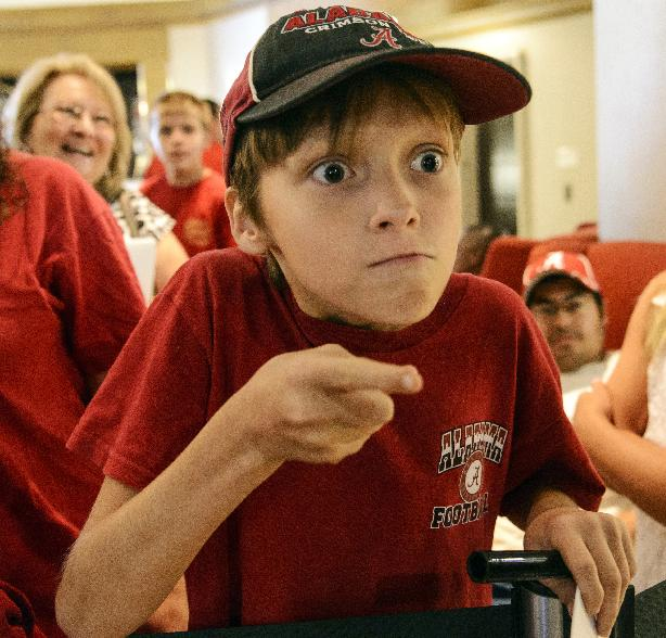 Alabama fan Tristan Sorrelle does his Nick Saban impression at the Southeastern Conference NCAA college football media days Thursday, July 17, 2014, in Hoover, Ala