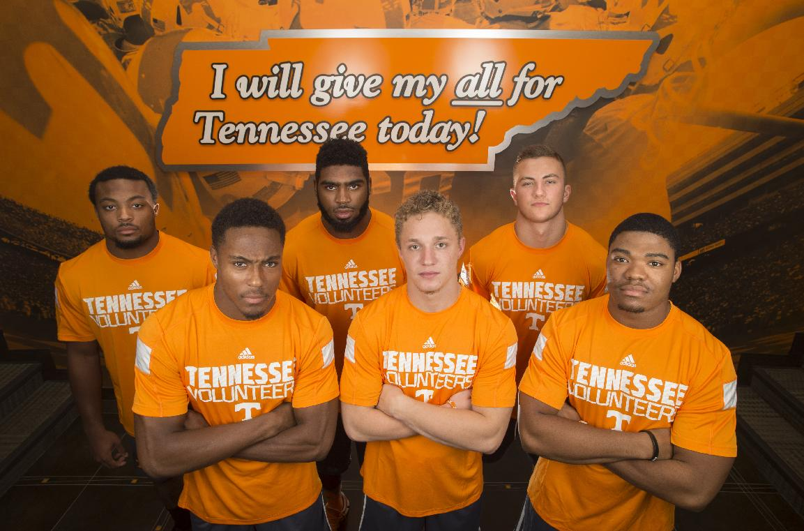 Tennessee football team freshmen Elliot Berry, Evan Berry, Neiko Creamer, Vic Wharton, Dillon Bates, and Todd Kelly, Jr., from left, pose for a portrait at the University of Tennessee Anderson Training Center in Knoxville, Tenn. on Friday, July 18, 2014
