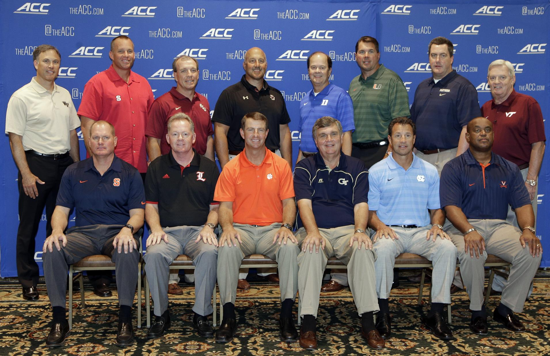 Atlantic Coast Conference football coaches pose for a group photo during the ACC Football kickoff in Greensboro, N.C., Monday, July 21, 2014. The coaches are, back row from left: Wake Forest's Dave Clawson, North Carolina State's Dave Doeren, Florida State's Jimbo Fisher, Boston College's Steve Addazio, Duke's David Cutcliffe, Miami's Al Golden, Pittsburgh's Paul Chryst, and Virginia Tech's Frank Beamer. Front row, from left are: Syracuse's Scott Shafer, Louisville's Bobby Petrino, Clemson's Dabo Swinney, Georgia Tech's Paul Johnson, North Carolina's Larry Fedora, and Virginia's Mike London