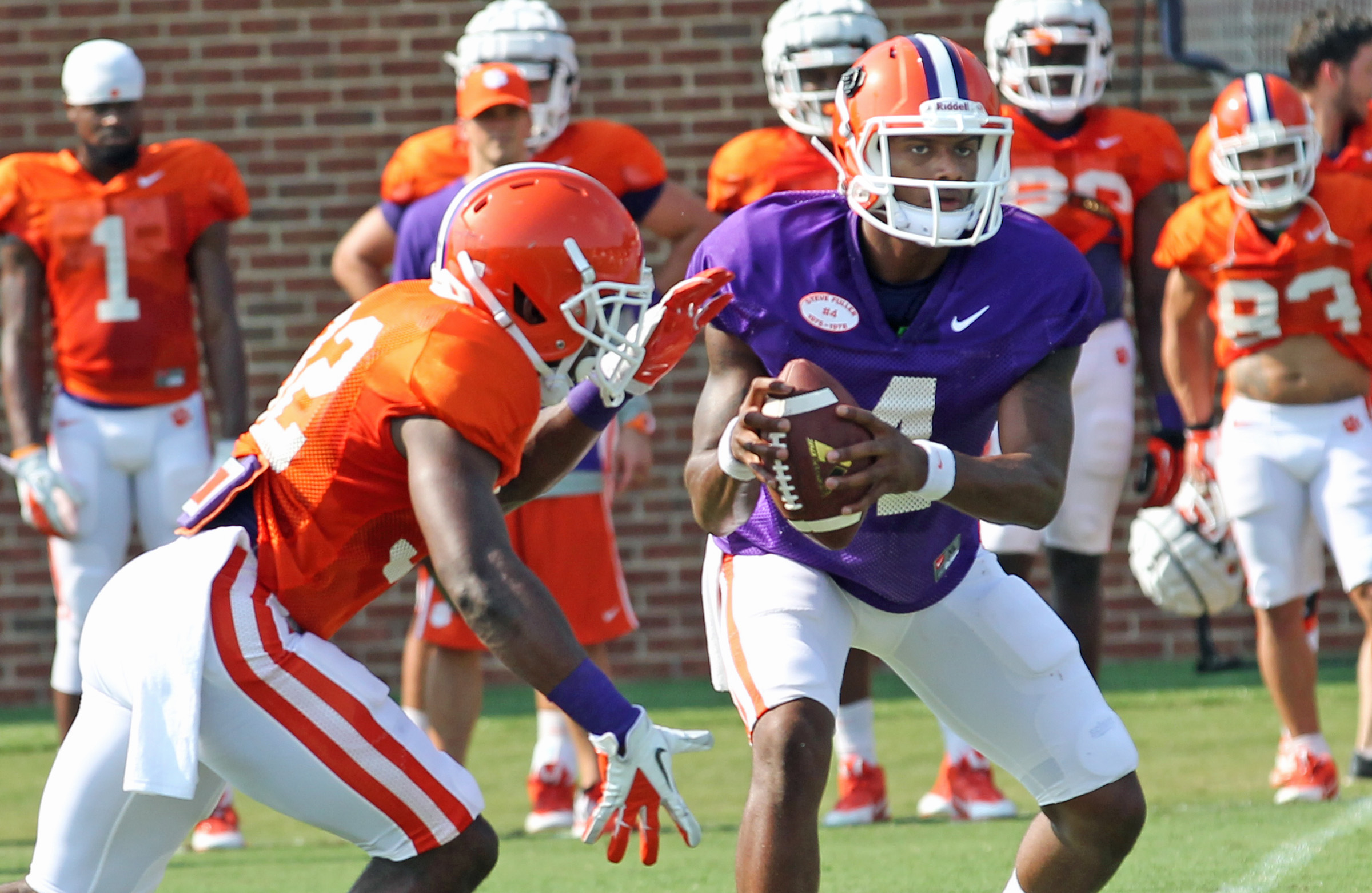Clemson quarterback Deshaun Watson, right, fakes a hand-off to running back C.J. Davidson during the Tigers' NCAA college football practice on Wednesday, Aug. 6, 2014 in Clemson, S.C