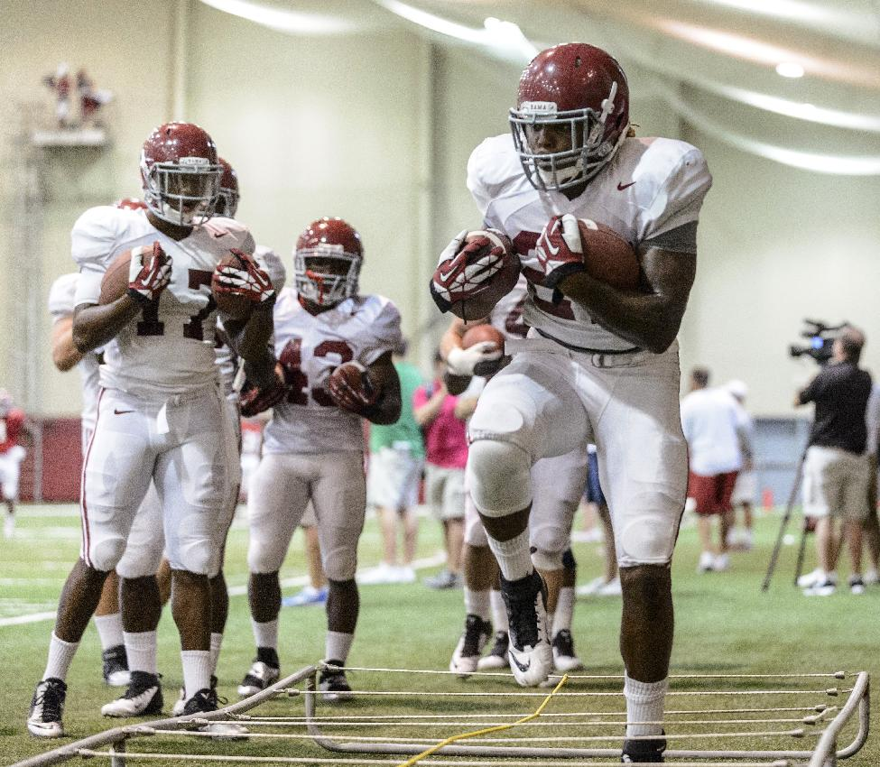 Alabama running back Derrick Henry (27) works through running back drills during the NCAA college football team's practice, Thursday, Aug. 7, 2014, in Tuscaloosa, Ala