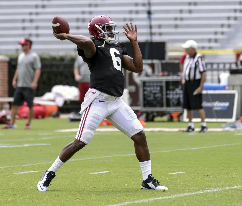 Alabama quarterback Blake Sims (6) works through drills before the scrimmage at football practice, Saturday, Aug. 9, 2014, at Bryant-Denny Stadium in Tuscaloosa, Ala