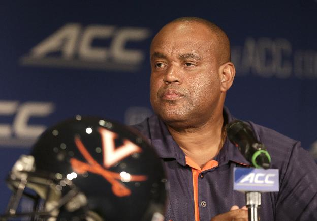 In this July 21, 2014, file photo, Virginia head coach Mike London answers a question during a news conference at the Atlantic Coast Conference Football kickoff in Greensboro, N.C