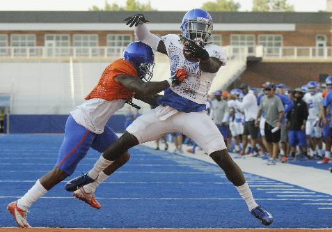 Boise State running back Jay Ajayi scores a touchdown during during the NCAA college football team's scrimmage Friday, Aug. 15, 2014, in Boise, Idaho